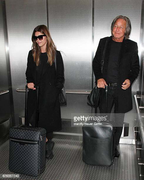Mohamed Hadid and Shiva Safai are seen at LAX on November 28 2016 in Los Angeles California