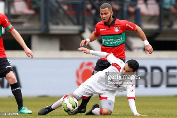 Mohamed Hamdaoui of Telstar Gregor Breinburg of NEC Nijmegen during the Dutch Jupiler League match between NEC Nijmegen v Telstar at the Goffert...