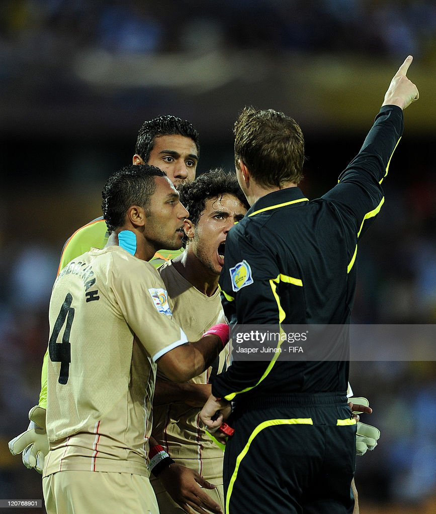 Mohamed Ibrahim (L), goalkeeper Ahmed Elshenawi (2nd L) and Omar Gaber (2nd R) of Egypt disagree with a decision of referee Markus Strombergsson (R) during the FIFA U-20 World Cup Colombia 2011 round of 16 match between Argentina and Egypt at the Atanasio Girardot stadium on August 9, 2011 in Medellin, Colombia.