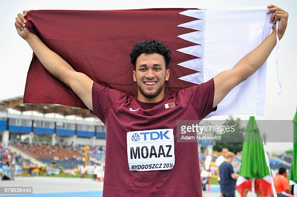 Mohamed Ibrahim Moaaz from Qatar celebrates winning a gold medal in men's discus throw during the IAAF World U20 Championships at the Zawisza Stadium...