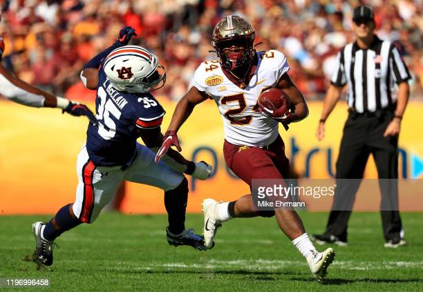 Mohamed Ibrahim of the Minnesota Golden Gophers rushes during the 2020 Outback Bowl against the Auburn Tigers at Raymond James Stadium on January 01,...