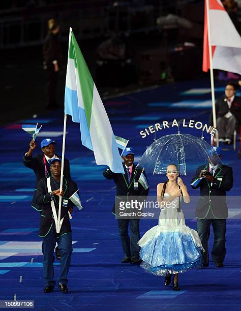 Mohamed Kamara of Sierra Leone carries the flag during the Opening Ceremony of the London 2012 Paralympics at the Olympic Stadium on August 29 2012...