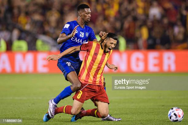 Mohamed Kanno of Al Hilal battles for the ball with Anice Badri of ES Tunis during the FIFA Club World Cup 2nd round match between Al Hilal and...