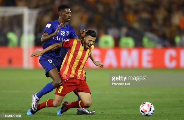 Mohamed Kanno of Al Hilal SFC tackles Anice Badri of Esperance Sportive de Tunis during the FIFA Club World Cup 2nd round match between Al Hilal and...