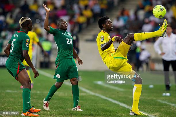 Mohamed Koffi and Wilfried Leon Bakary Sanou of Burkina Faso and Emmanuel Adebayor of Togo during the 2013 African Cup of Nations 4th Quarter Final...