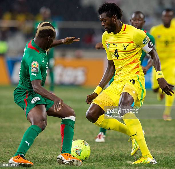 Mohamed Koffi of Burkina Faso and Emmanuel Adebayor of Togo during the 2013 African Cup of Nations 4th Quarter Final match between Burkina Faso and...