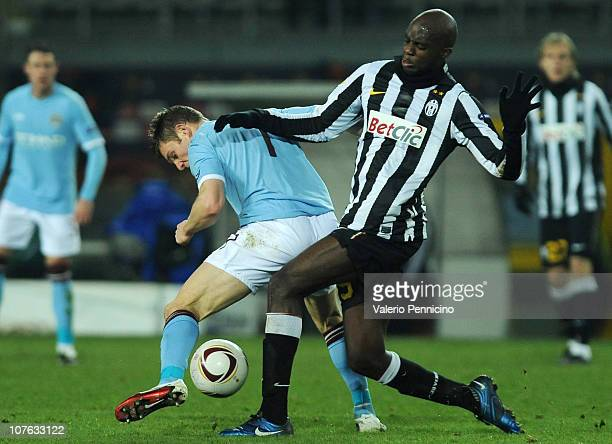 Mohamed Lamine Sissoko of Juventus FC battles for the ball with James Milner of Manchester City during the UEFA Europa League group A match between...