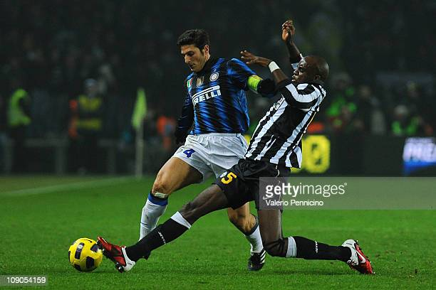 Mohamed Lamine Sissoko of Juventus FC battles for the ball with Javier Zanetti of FC Internazionale Milano during the Serie A match between Juventus...