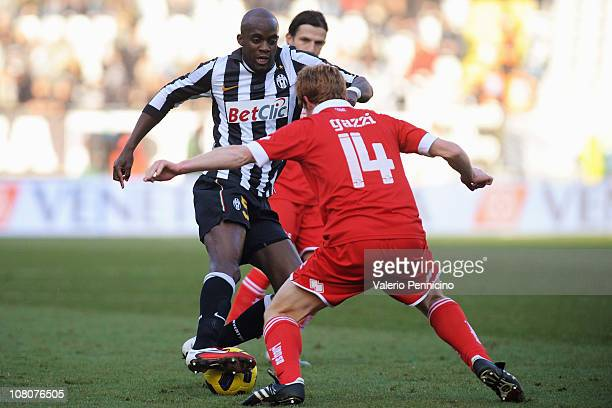 Mohamed Lamine Sissoko of Juventus FC is challenged by Alessandro Gazzi of AS Bari during the Serie A match between Juventus FC and AS Bari at...