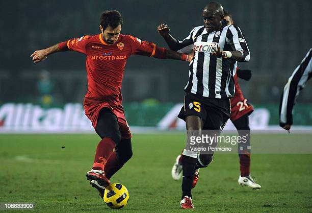 Mohamed Lamine Sissoko of Juventus FC takes on Mirko Vucinic of AS Roma during the Tim Cup match between Juventus FC and AS Roma at Olimpico Stadium...