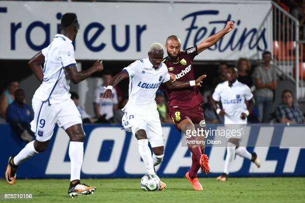 Mohamed Lamine Yattara of Auxerre and John Bostock of Lens during the French Ligue 2 match between match between Auxerre and Lens at Stade Abbe...