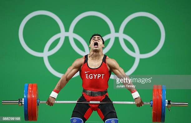 Mohamed Mahmoud of Egypt lifts during the Men's 77kg Group A weightlifting contest on Day 5 of the Rio 2016 Olympic Games at Riocentro - Pavilion 2...