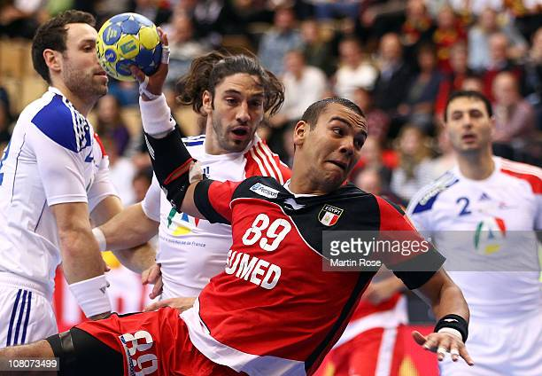 Mohamed Mamdouh of Egypt is challenged by Bertrand Gille of France during the Men's Handball World Championship Group A match between Egypt and...