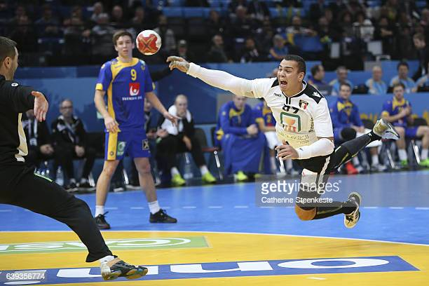 Mohamed Mamdouh Shebib of Egypt is shooting the ball against Andreas Palicka of Sweden during the 25th IHF Men's World Championship 2017 match...