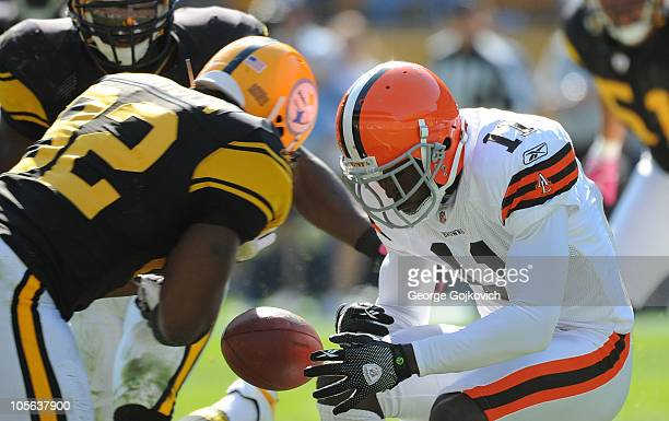 Mohamed Massaquoi of the Cleveland Browns is unable to catch a pass as he is hit by James Harrison of the Pittsburgh Steelers during a game at Heinz...