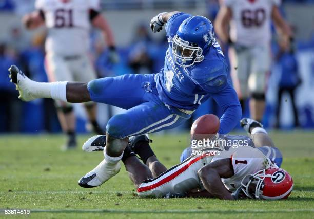 Mohamed Massaquoi of the Georgia Bulldogs fumbles the ball after being hit by Micah Johnson of the kentucky Wildcats during the game at Commonwealth...