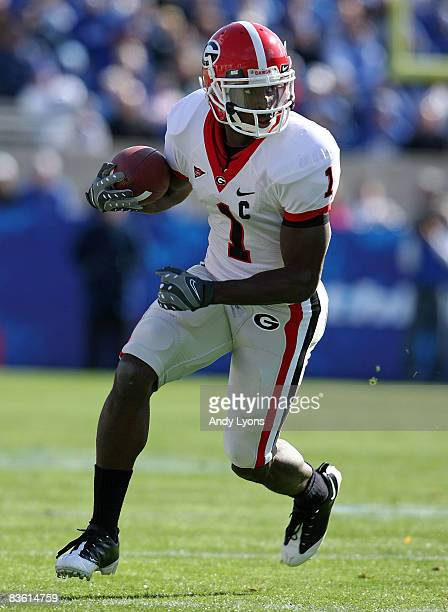 Mohamed Massaquoi of the Georgia Bulldogs runs with the ball during the game against the Kentucky Wildcats at the Commonwealth Stadium on November 8,...