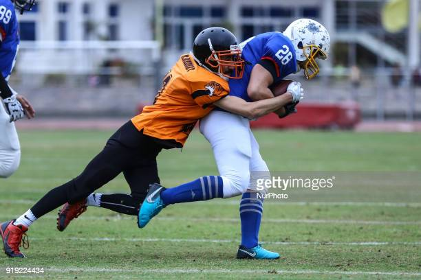 Mohamed Medhat of the Tigers tackles Joy of the Warriors during the Egyptian league of American football in Cairo Egypt on 16 Feburary 2018 This...