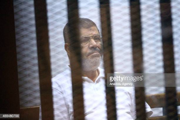 Mohamed Morsi is seen during a trial over the Wadi el-Natrun prison case at Cairo Police Academy in Egypt, on September 15, 2014. Cairo Criminal...