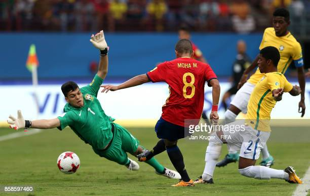 Mohamed Moukhliss of Spain scores the opening goal past Gabriel Brazao of Brazil during the FIFA U17 World Cup India 2017 group D match between...