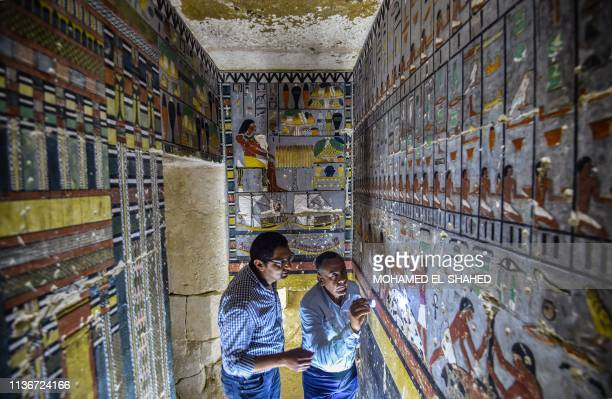 Mohamed Mujahid head of the Egyptian mission which discovered the tomb of the ancient Egyptian nobleman Khewi dating back to the 5th dynasty inspects...