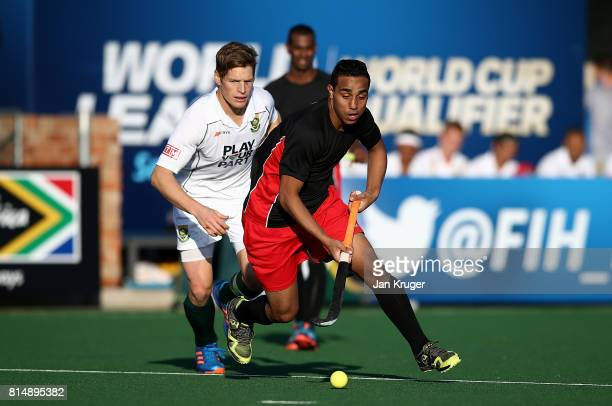 Mohamed Nasr of Egypt battls with Tim Drummond of South Africa during day 4 of the FIH Hockey World League Men's Semi Finals Pool B match between...