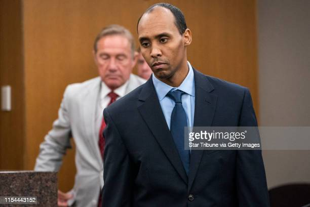Mohamed Noor walks to the podium to be sentenced