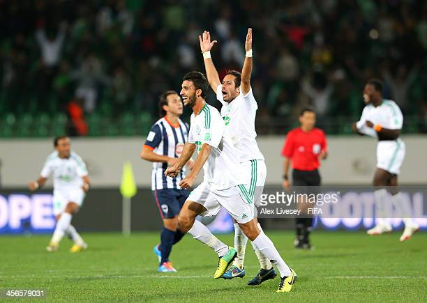 Mohamed Oulhaj and Adil Karrouchy of Raja Casablanca celebrate after victory over CF Monterrey in the FIFA Club World Cup Quarter Final match between...