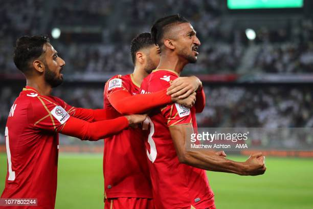 Mohamed Saad Alromaihi of Bahrain celebrates scoring his side's first goal to make the score 01 with his teammates during the AFC Asian Cup Group A...