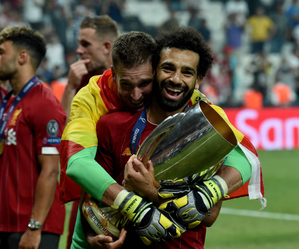 SUPER COUPE EUROPE UEFA 2019 Mohamed-salah-and-adrian-of-liverpool-with-the-super-cup-trophy-at-picture-id1168076304?k=6&m=1168076304&s=612x612&w=0&h=p2jFhmObdkb4bPODKXz8rGfUw0QrWKyS6M76Nm0X5y4=