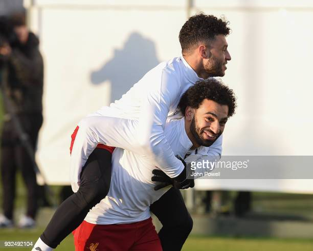Mohamed Salah and Alex OxladeChamberlain of Liverpool during the training session at Melwood Training Ground on March 15 2018 in Liverpool England