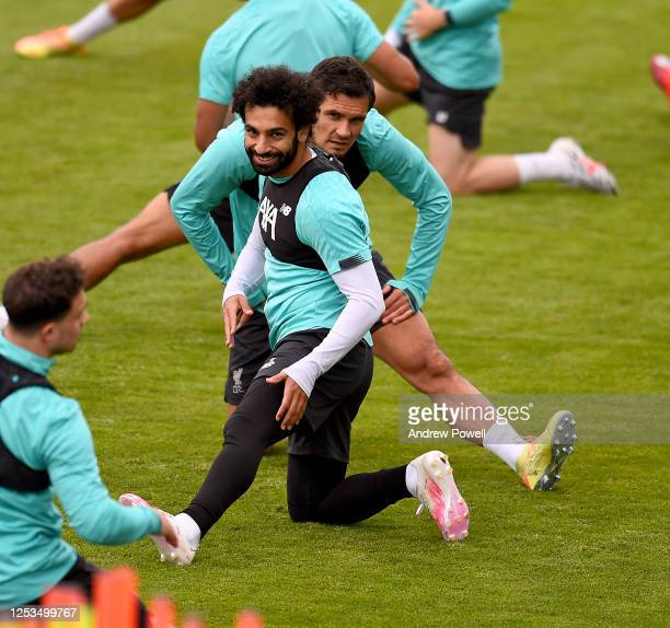 Mohamed Salah and Dejan Lovren of Liverpool during a training session at Melwood Training Ground on June 30 2020 in Liverpool England