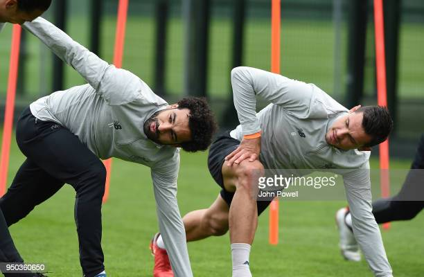 Mohamed Salah and Dejan Lovren of Liverpool during a training session at Melwood Training Ground on April 23 2018 in Liverpool England