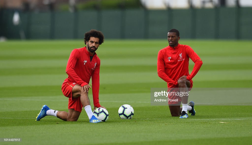 Mohamed Salah and Georginio Wijnaldum of Liverpool during a training session at Melwood Training Ground on August 10, 2018 in Liverpool, England.