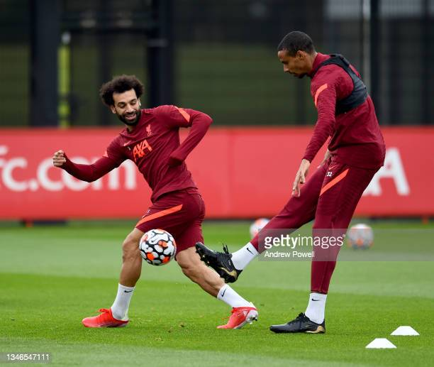 Mohamed Salah and Joel Matip of Liverpool during a training session at AXA Training Centre on October 14, 2021 in Kirkby, England.