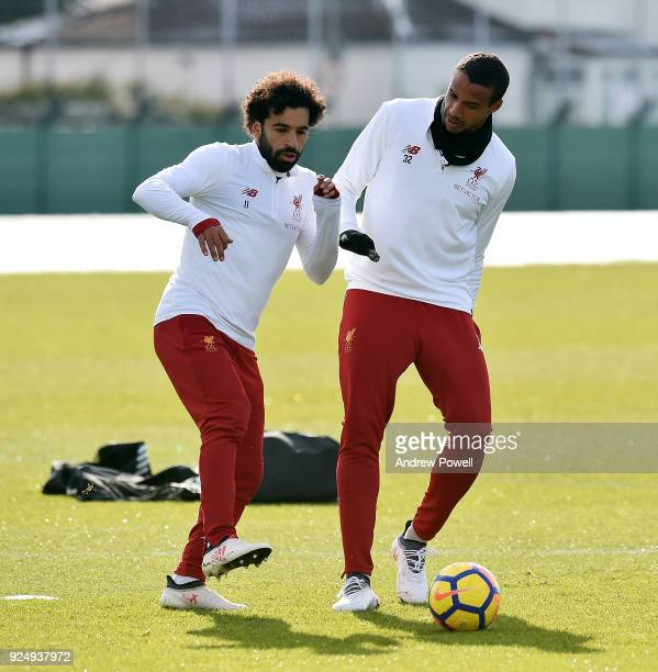 Mohamed Salah and Joel Matip of Liverpool during a training session at Melwood Training Ground on February 27 2018 in Liverpool England