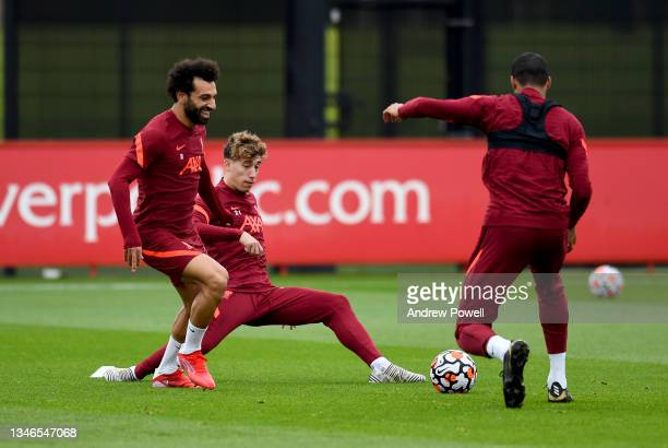 Mohamed Salah and Kostas Tsimikas of Liverpool during a training session at AXA Training Centre on October 14, 2021 in Kirkby, England.