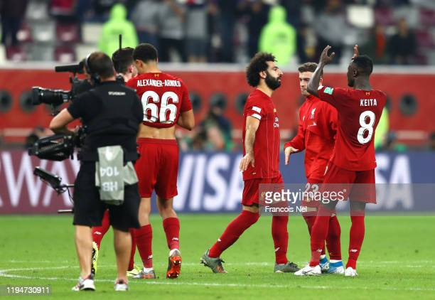 Mohamed Salah and Naby Keita of Liverpool celebrate victory after the FIFA Club World Cup semi-final match between Monterrey and Liverpool at...
