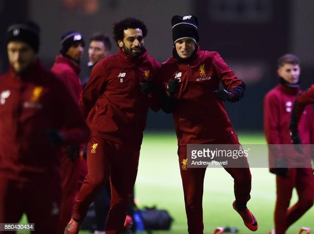 Mohamed Salah and Philippe Coutinho of Liverpool during a training session at Melwood Training Ground on November 27 2017 in Liverpool England