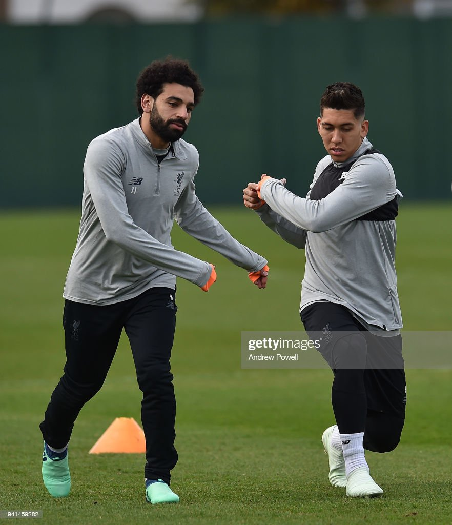 Mohamed Salah and Roberto Firmino of Liverpool during a training session at Melwood Training Ground on April 3, 2018 in Liverpool, England.