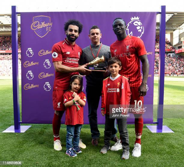 Mohamed Salah and Sadio Mane of Liverpool with the golden boot at the end of the Premier League match between Liverpool FC and Wolverhampton...