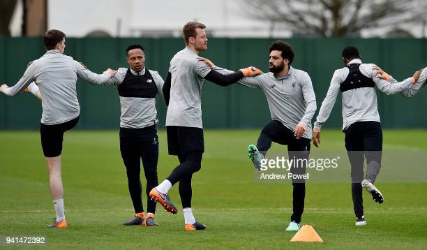 Mohamed Salah and Simon Mignolet of Liverpool during a training session at Melwood Training Ground on April 3 2018 in Liverpool England