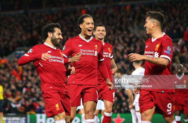 Mohamed Salah and Virgil van Dijk of Liverpool celebrate with goalscorer Roberto Firmino after scoring the fifth goal during the UEFA Champions...