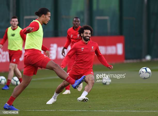 Mohamed Salah and Virgil van Dijk of Liverpool during a training session at Melwood Training Ground on October 18 2018 in Liverpool England
