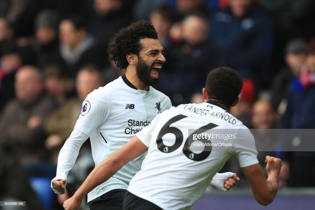 Mohamed Salah celebrates with Trent Alexander-Arnold of Liverpool during the Premier League match between Crystal Palace and Liverpool at Selhurst Park on March 31, 2018 in London, England.