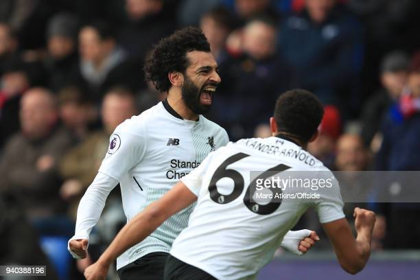 Mohamed Salah celebrates with Trent AlexanderArnold of Liverpool during the Premier League match between Crystal Palace and Liverpool at Selhurst...