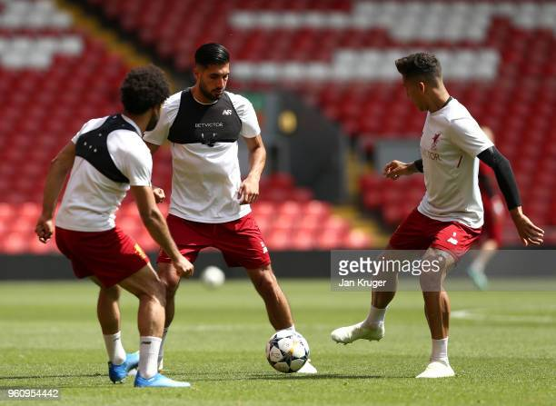 Mohamed Salah Emre Can and Roberto Firmino of Liverpool pass the ball during a training session at Anfield on May 21 2018 in Liverpool England
