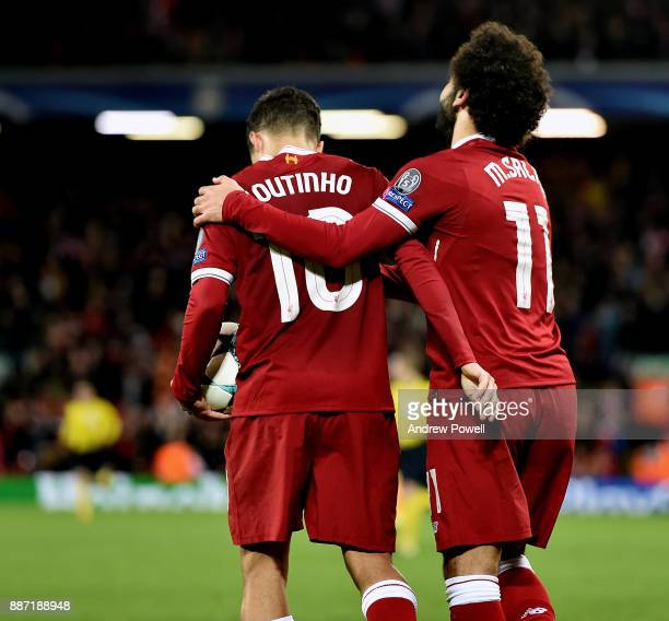 Mohamed Salah gives Philippe Coutinho of Liverpool the match ball after scoring a hatrick during the UEFA Champions League group E match between...