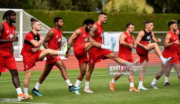 Mohamed Salah Harvey Elliott Rhian Brewster and Dejan Lovren of Liverpool during a training session on July 30 2019 in EvianlesBains France