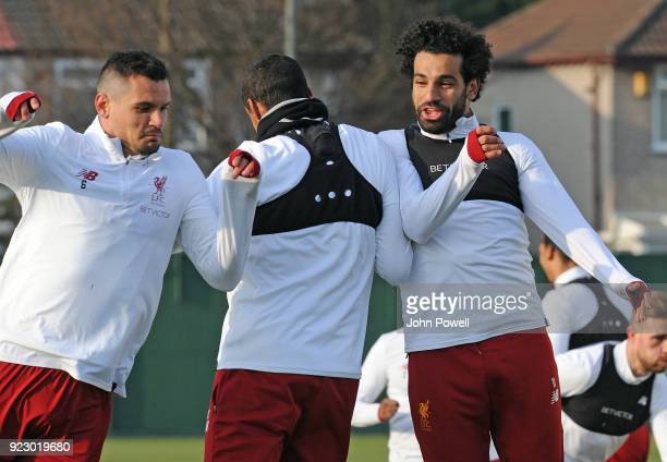 Mohamed Salah Joel Matip and Dejan Lovren of Liverpool during a training session at Melwood Training Ground on February 22 2018 in Liverpool England